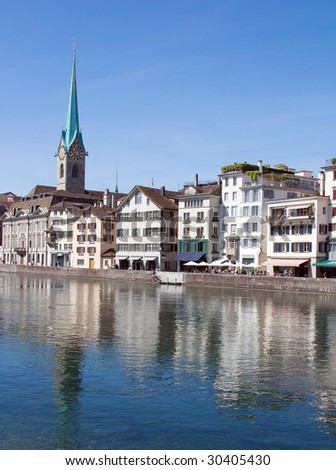 Fraumuenster cathedral on the bank of Limmat river (Zurich, Switzerland)