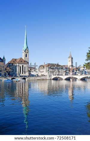 Fraumunster and St. Peter's churches over Limmat river in Zurich, Swizerland - stock photo