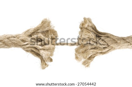 Frayed rope about to break close up. Isolated on white background. - stock photo