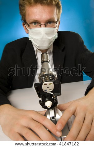 Freak doctor with microscope - stock photo