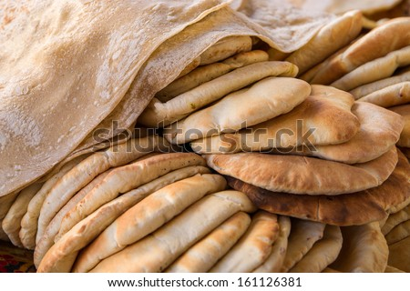 Freashly baked Khubz and Pide, typical arab flatbreads - stock photo