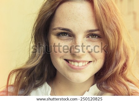 freckled hipster young beautiful woman street outdoor portrait with beautiful eyes