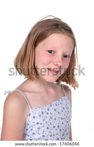 freckled little girl with short straight hair smiling
