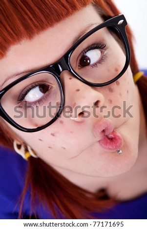freckles girl  making face, red-haired, close up - stock photo