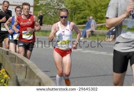 FREDERICIA - MAY 2: Leading female runner passing 14 km. Little Belt Half Marathon. Alyson Dixon winner of the race in 1:16:01. Little Belt Half Marathon 2nd of May, 2009. Denmark. - stock photo
