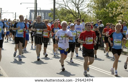 FREDERICIA - MAY 2: People running Little Belt Half Marathon from Middelfart to Fredericia. Crossing the Old Little Belt Bridge. 2nd of May, 2009, Denmark. - stock photo