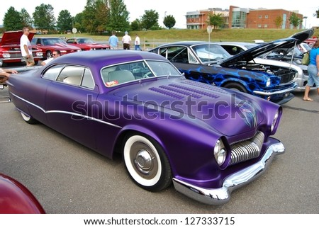 FREDERICK, MD - SEPTEMBER 16 : 1950 Purple Ford Coupe Frontal Design Detail at a Car Show on September 16, 2012 in Frederick, MD USA. A Alzheimer's Benefit Car Show to fund research in Maryland. - stock photo