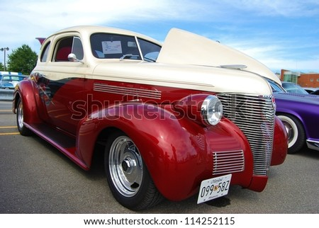 FREDERICK, MD- SEPTEMBER 16: 1939 Red, and White Chevy Coupe on Sept. 16, 2012 in Frederick , MD USA. Alzheimer's Association Benefit Car Show at Motor Vehicle Administration in Maryland - stock photo