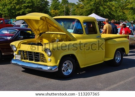 FREDERICK, MD- SEPTEMBER 16: Vintage Yellow Ford Truck  at  a Car Show on Sept. 16, 2012 in Frederick , MD USA.  Alzheimer's Association Benefit Car Show at  Motor Vehicle Administration in Maryland. - stock photo