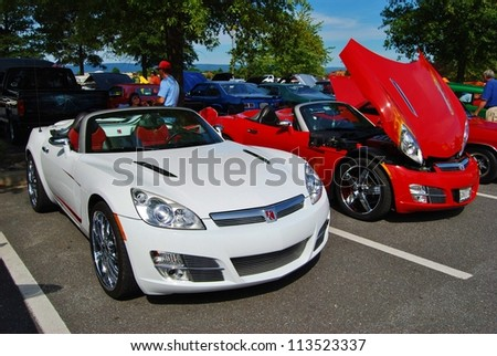 FREDERICK, MD  SEPTEMBER 16: 2011 White,and Red Saturn Sky Convertible On