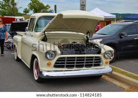 FREDERICK, MD- SEPTEMBER 16:White Vintage Ford Pickup Truck on Sept. 16, 2012 in Frederick , MD USA. Alzheimer's Association Benefit Car Show at Motor Vehicle Administration in Maryland. - stock photo