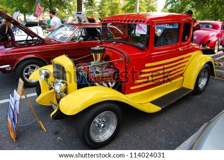 FREDERICK, MD- SEPTEMBER 16: 1962 Yellow ,and Red Ford Coupe on Sept. 16, 2012 in Frederick , MD USA. Alzheimer's Association Benefit Car Show at Motor Vehicle Administration in Maryland. - stock photo