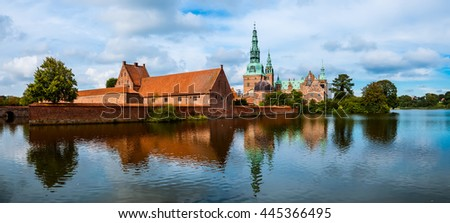 Frederiksborg castle reflected in the lake in Hillerod, Denmark. Renaissance castle and romantic lake near Copenhagen. - stock photo