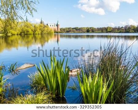 Frederiksborg Slot and Castle Lake. Royal Palace in Hillerod by sunny day, Denmark - stock photo