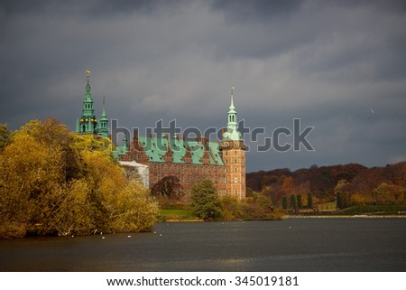 Frederiksborg slot in beautiful evening light in during autumn - stock photo