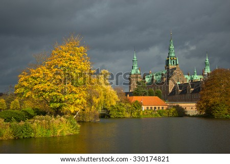 Frederiksborg slot in beautifull evening light in during autumn - stock photo