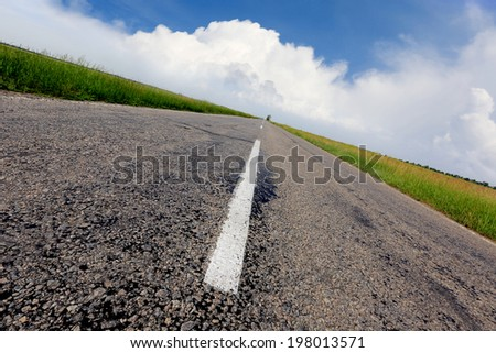 Free asphalt road under nice sky - stock photo