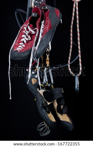 free climbing equipment against black background