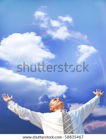 free fly   successful businessman upon background beautiful heaven rainbow