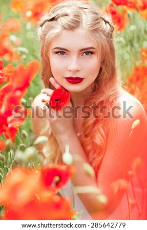 Free Happy Blond Woman Enjoying Nature In Poppy Field. Beauty Girl Outdoor. Freedom concept. Sunbeams. Enjoyment. - stock photo