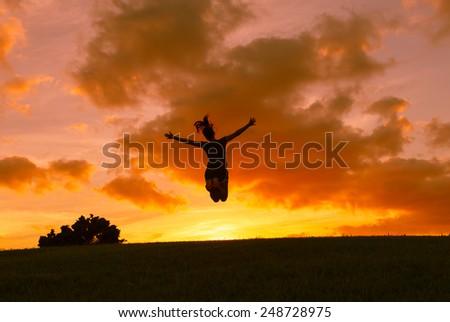 Free happy woman enjoying nature - stock photo