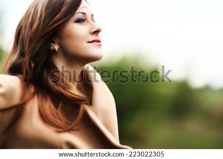 Free Happy Woman Enjoying Nature and Wind. Beauty Girl Outdoor. Freedom concept. Beauty Girl over Sky. - stock photo