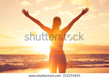 Free happy woman open arms at sunset - stock photo