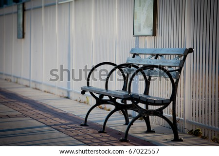 Free metal and wooden benche at a park in Newport, New Jersey at winter(on Hudson river) - stock photo