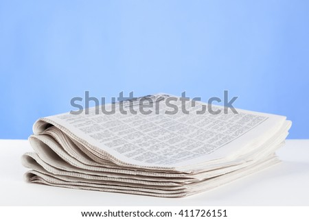 Free newspaper on the table, closeup shot - stock photo