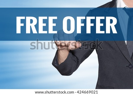 Free Offer word Business man touching on blue virtual screen - stock photo