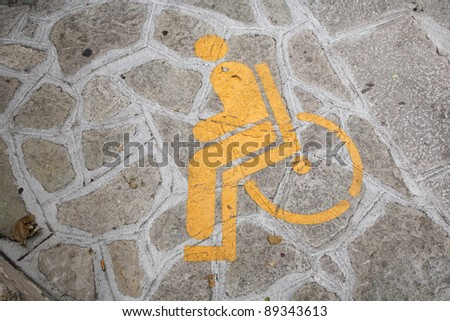 Free parking for disabled only - found in a little Italian town. - stock photo