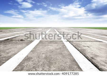 Free place for your car, plane, bike or people and gray road of runway and white marks  - stock photo