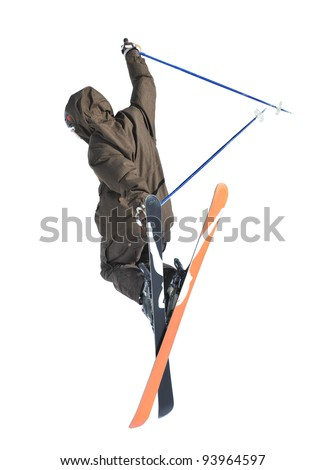 Free ride ski jumper with crossed skis performing a rear grab