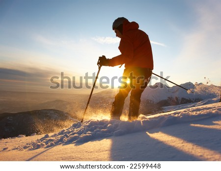 Free-rider skier moving down in snow powder at sunset; italian alps. - stock photo
