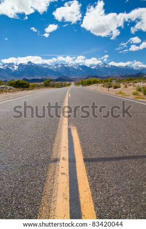 Free road with mountains in background - stock photo