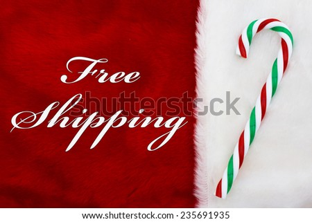 Free Shipping, A plush red stocking with a candy cane and words Free Shipping - stock photo