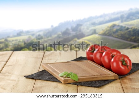 free space on desk and red fruits  - stock photo