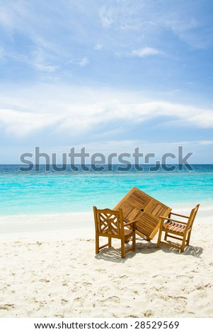 Free table for two on the beach with ocean view