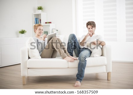 free time for a couple at home - stock photo
