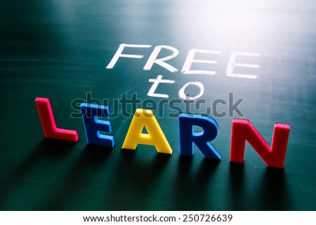 Free to learn concept, colorful words on blackboard - stock photo