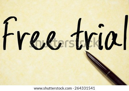 free trial text write on paper  - stock photo
