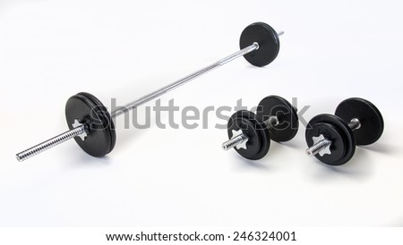 Free weight set with bar and dumb bells - stock photo