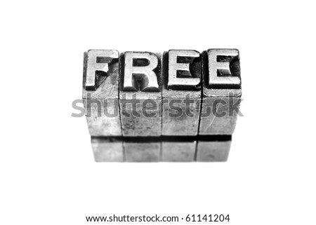 FREE written in metallic letters on a white background - stock photo