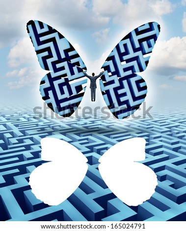 Freedom and creativity as an innovative businessman thinking outside the box escaping a maze or labyrinth by cutting out butterfly wings and taking flight overcoming adversity to a success journey. - stock photo