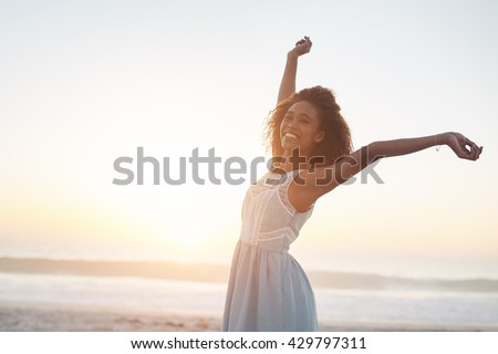 Freedom and sun at the beach - stock photo