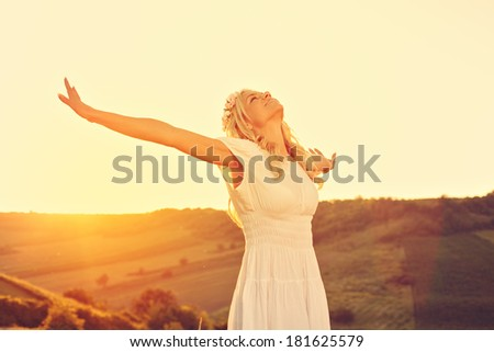Freedom. Attractive woman with arms outstretched. - stock photo
