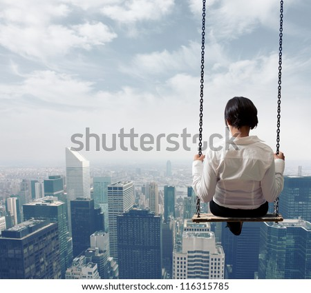 Freedom business woman on a swing - stock photo