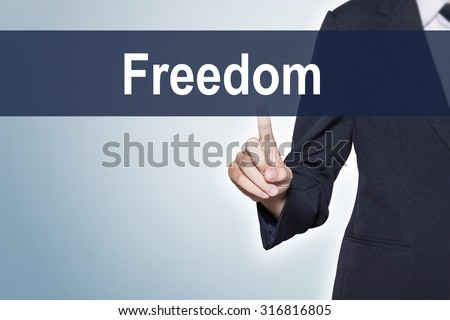 Freedom Business woman pushing hand on virtual screen for e-commerce background - stock photo