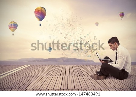 Freedom businessman working with laptop outdoor - stock photo