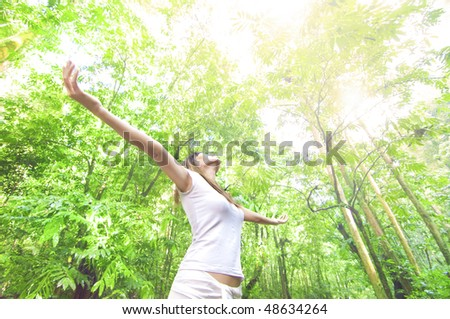 freedom concept photo in rain forest with ealry ray of lights - stock photo